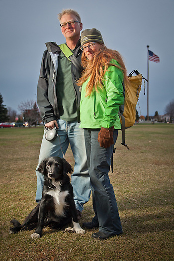 Environmental Advocates, Dennis Gann and Valerie Connor with their dog Cricket, walking home on a damp blistery day on the Delaney Park Strip, Anchorage (Clark James Mishler)