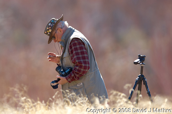 "Photographer checking his filter for dust. Elderhostel ""Southwest Photography"" Workshop Day 2. Kelly Place Cortez Colorado. Image taken with a Nikon D2xs and 400 mm f/2.8 lens (ISO 100, f/2.8, 1/750 sec) (David J Mathre)"