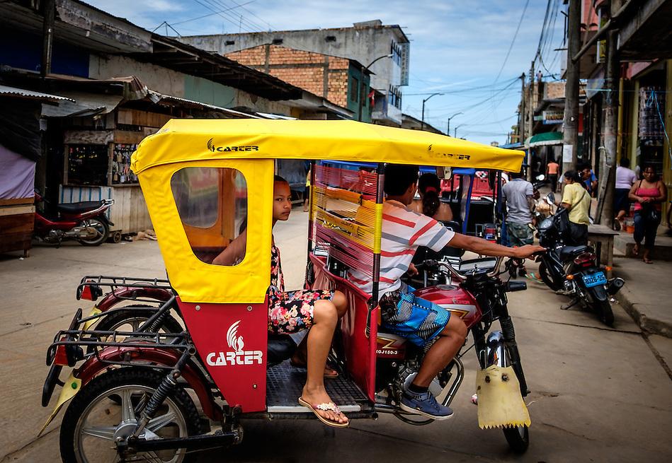 NAUTA, PERU - CIRCA OCTOBER 2015: Typical motorbike, ricksaw in the streets of Nauta in the Peruvian Amazon (Daniel Korzeniewski)