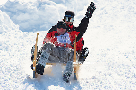 GRINDELWALD, SWITZERLAND - MARCH 07, 2009: Unidentified men ride traditional horn-sledge at 12-th annual Horn-Sledge Race from Alpiglen to Grund in Grindelwald, Switzerland. (Dmitry Chulov)