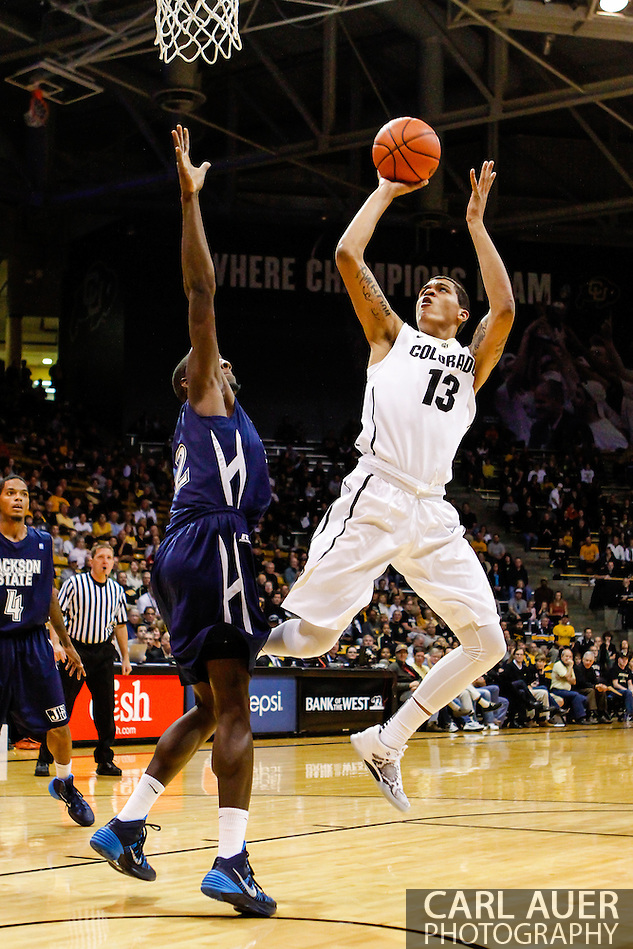 November 16th, 2013:  Colorado Buffaloes freshman forward Dustin Thomas (13) attempts a shot in the first half of the NCAA Basketball game between the Jackson State Tigers and the University of Colorado Buffaloes at the Coors Events Center in Boulder, Colorado (Carl Auer/ZUMAPRESS.com)