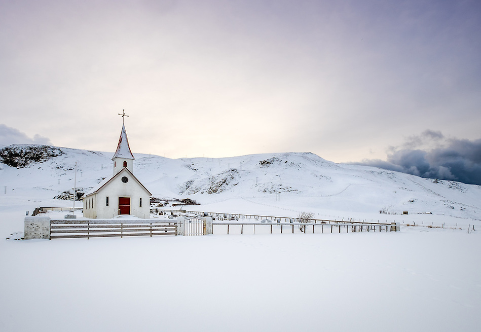 VIK, ICELAND - CIRCA MARCH 2015: Reyniskirkja, a Lutheran church near Vik in Iceland. It's built against Mt. Reynisfjall on the road down to Reynisfjara. (Daniel Korzeniewski)