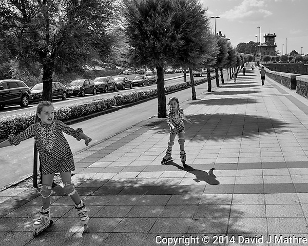 Sidewalk Skaters in Getxo Spain. Image taken with a Leica X2 camera (ISO 100, 24 mm, f/6.3, 1/640 sec). Raw image processed with Capture One Pro, and Photoshop CC 2014 (David J Mathre)