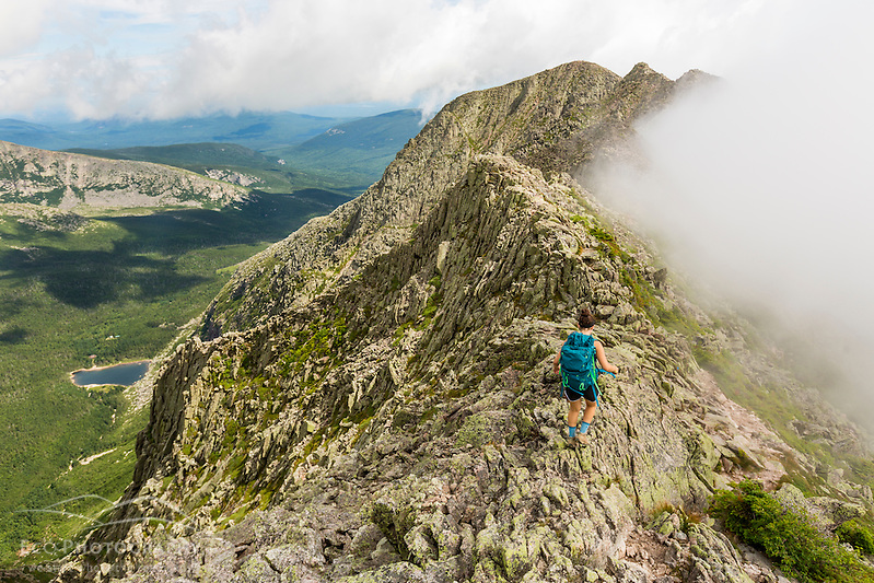 A teenage girl hikes the Knife Edge Trail on Mount Katahdin in Maine's Baxter State Park. (Jerry and Marcy Monkman)
