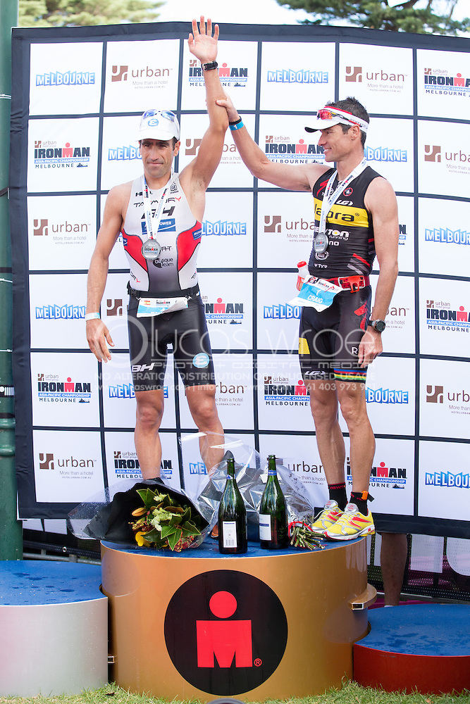 Eneko LLANOS (ESP) Congratulated By Craig ALEXANDER (AUS) On The Podium. Ironman Asia Pacific Championship Melbourne. Triathlon. Frankston And St Kilda, Melbourne, Victoria, Australia. 24/03/2013. Photo By Lucas Wroe (Lucas Wroe)