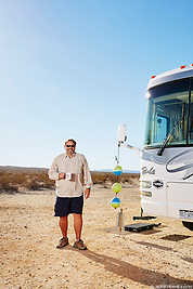Hector Lopez stands outside his Class A motorhome while camping in the Anza Borrego desert of California. (Seth K Hughes)