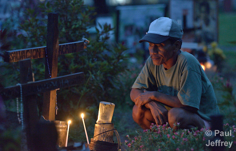 Pouldo Bacatio pauses to remember his grandmother Salvacion, who was buried in a common grave in a church yard in Palo, in the Philippines province of Leyte. She and thousands of others were killed by Typhoon Haiyan, known locally as Typhoon Yolanda. (Paul Jeffrey)