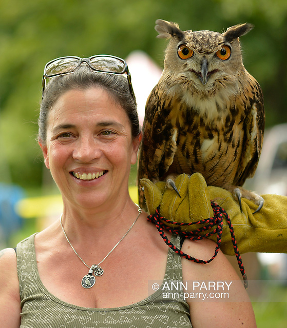 """""""Old Westbury, NY, U.S. August 23, 2014. CATHY HORVATH is with AUGIE, a 4-year-old male Eurasian Eagle Owl (Bubo bubo), from WINORR, Wildlife in Need of Rescue and Rehabilitation, at the 54th Annual Long Island Scottish Festival and Highland Games, at Old Westbury Gardens. WINORR is run by Cathy and her husband Bobby, licensed animal rehabilitators in North Massapequa. (© 2014 Ann Parry/AnnParry.com)"""