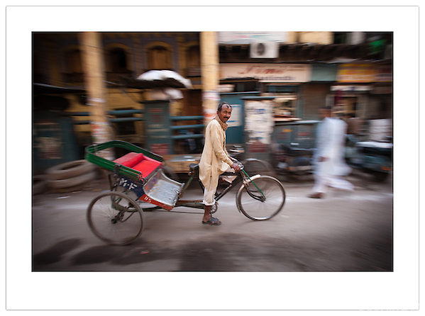 A bicycle rickshaw passing through Chandni Chowk, Old Delhi, India (© 2013  Ian Mylam)