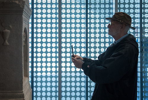 U of T professor Tim Kennedy photographs a sculpture with his iPhone at the Tampa Museum of Art. (Clark James Mishler)