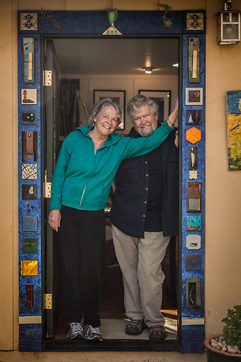 Humorist Yvonne Henry and her photographer husband, Chick Harrity, in the door of their sharred Calistoga backyard office. (Clark James Mishler)