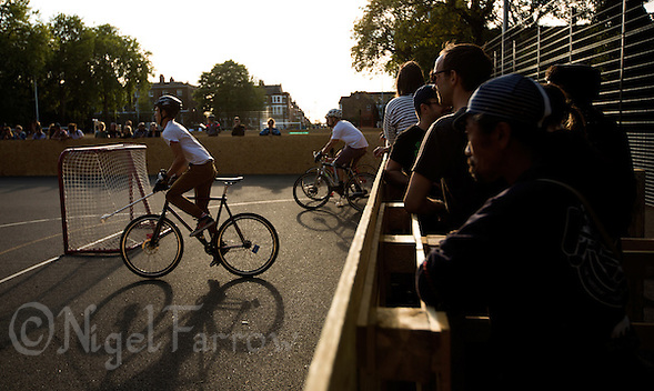 17 AUG 2014 - LONDON, GBR - Players from Partisans race from the line for for the joust, the start of a game where a player from each team charges for the ball placed in the centre of the court, at the 2014 London Open Bike Polo tournament at Highbury Fields in London, Great Britain  (PHOTO COPYRIGHT © 2014 NIGEL FARROW, ALL RIGHTS RESERVED) (NIGEL FARROW/COPYRIGHT © 2014 NIGEL FARROW : www.nigelfarrow.com)