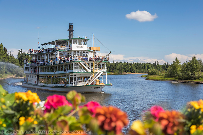 Historic Riverboat Discovery takes tourist down the Chena River in Interior Alaska's golden heart city of Fairbanks, Alaska (Patrick J Endres / AlaskaPhotoGraphics.com)