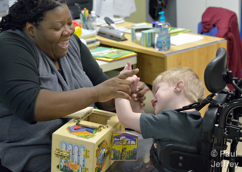 Kristen Dacres works with a student with developmental disabilities in the school at Lover's Lane United Methodist Church in Dallas, Texas. Dacres is assistant director of the school. (Paul Jeffrey)