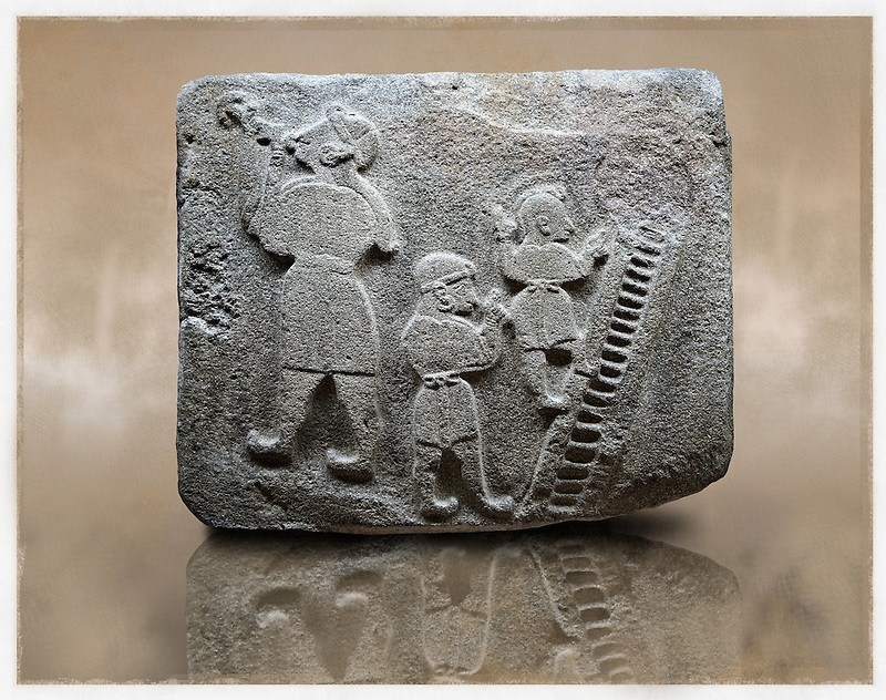 Picture & image of a Neo-Hittite orthostat showing a Conjurer & acrobats from Alacahöyük, Alaca Çorum Province, Turkey. Ancora Archaeological Museum. The conjurer on the left has long hair and is swallowing a dagger whilst the acrobats go up the stairs without holding on. All the figures are wearing horned headress and large looped earings. The acrobats are thought to be foreigners which is why they are smaller than the conjurer. Old Bronze age Chalcolithic Period. (Paul E Williams)