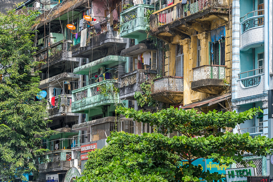 YANGON, MYANMAR - CIRCA DECEMBER 2013: View of the facade of a typical apartment building in the city of Yangon. (Daniel Korzeniewski)
