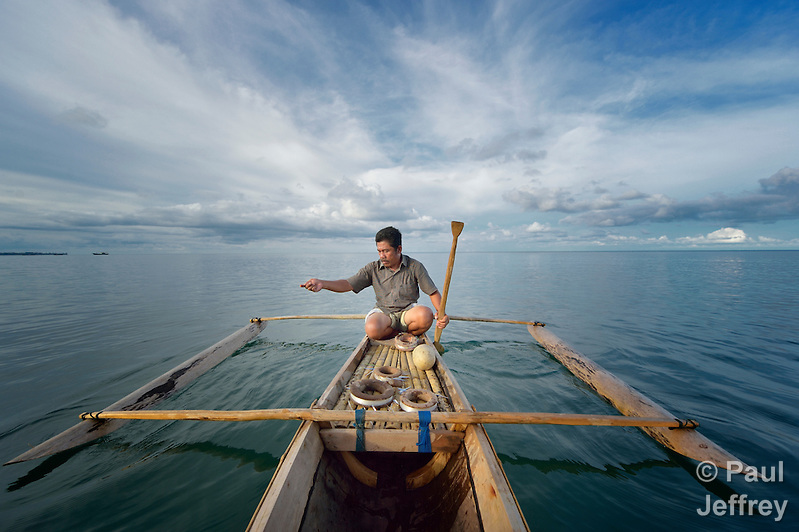 Nurul Huda fishes from his small fishing boat off the Indonesian island of Nias. Huda, a resident of the seaside village of Olora, survived a giant March 2005 earthquake on Nias, yet lost much of his fishing equipment. Church World Service, a member of the ACT Alliance, provided new nets and boats for the fishers of Olora, allowing them to restart their lives. Yet fish have grown scarce in recent years, while fuel prices have risen, making it harder for fishers to earn a living. Huda no longer can afford a motor, and so fishes closer to the island, where the fish are smaller. Climate change has also made it more difficult to predict fish movements, and changing weather patterns can surprise the fishermen at sea. Huda, not surprisingly, wonders if his 16-year old son should pursue another line of work. (Paul Jeffrey)