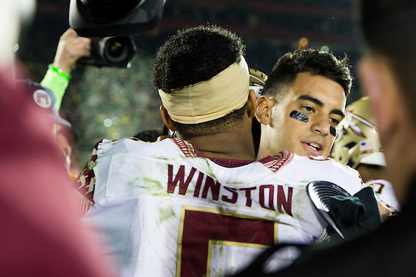 Marcus Mariota, Quarterback, University of Oregon, and Jameis Winston, quarterback, Florida State University. Photographed at the 2015 Rose Bowl Game in Pasadena, California, on January 1, 2015. (Photograph ©2015 Darren Carroll) (Darren Carroll)