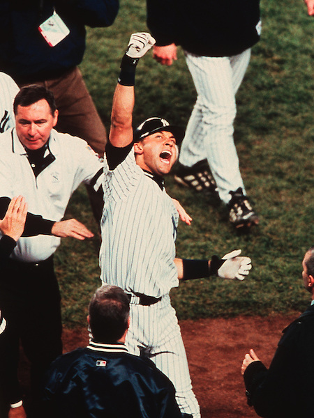 Derek Jeter emotions were high as he acknowledges the Yankee Stadium faithful after hitting a dramatic, 11th inning walk off game winning home run off of Arizona reliver Byung-Hyun Kim. (© 2001 Ron Vesely - All Rights Reserved)