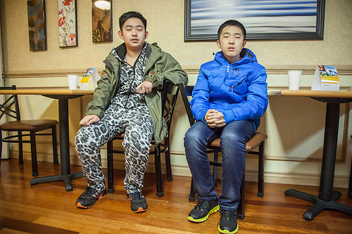 Korean Brothers at early morning Breakfast, Comfort Inn, Seattle Washington (© Clark James Mishler)