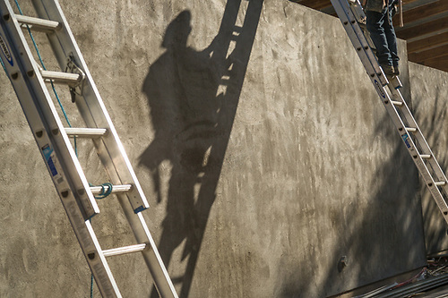 A worker decends a ladder at a onstruction, project on Cedar Street in Calistoga. (Clark James Mishler)