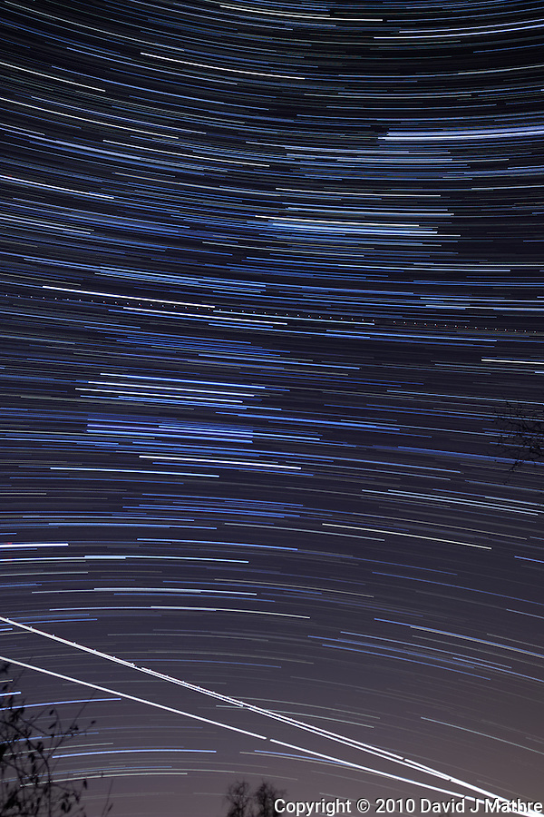 Late Fall Night Sky Image of Star and Jet Trails. Image taken with a Nikon D3x and 24 mm f/3.5 PC-E lens (ISO 400, f/4.0, 30 sec). Composite of 120 images over 1 hour combined with Startrails program. Hour 4. (David J Mathre)