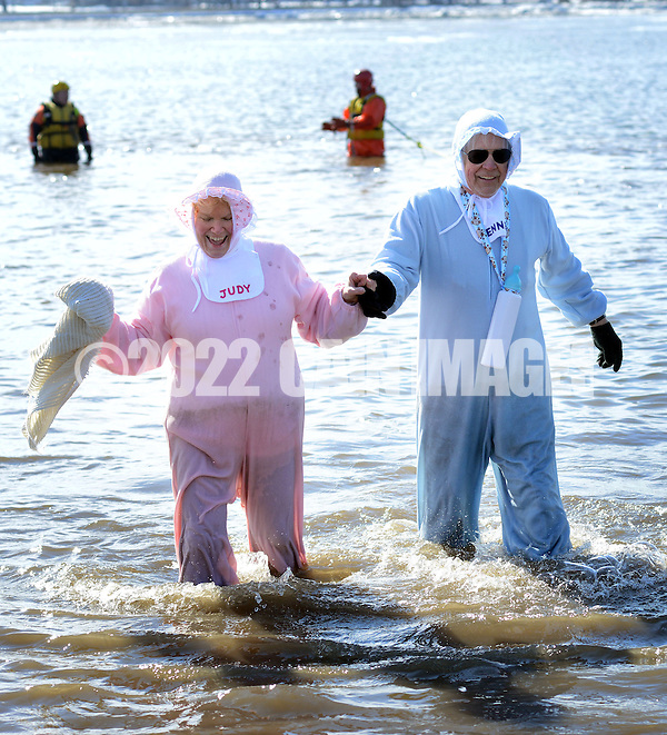 Judy Misoyianis of Vincenttown, New Jersey and Dennis Hart of Philadelphia, Pennsylvania dressed as Baby Boomers exit the 32 degree Delaware River during the eighth annual Eastern Polar Bear Plunge to benefit Special Olympics Pennsylvania (SOPA) Saturday January 30, 2016 at Neshaminy State Park in Bensalem, Pennsylvania. (Photo by William Thomas Cain) (William Thomas Cain/Cain Images)