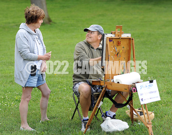 "From left, Addie Hocynec, of Lansdale, Pennsylvania and a painter herself, speaks with fellow artist John Schmidtberger as he paints a picture during the first ever Bucks County Plein Air Festival Wednesday June 8, 2016 at the Mercer Museum in Doylestown, Pennsylvania. The competitively-selected artists will paint outdoors ""en plein air"" or ""in open air"" over the course of three days in various locations throughout the county to create various landscapes and streetscapes. (Photo by William Thomas Cain) (William Thomas Cain)"