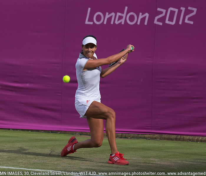 Ana Ivanovic..Tennis - OLympic Games -Olympic Tennis -  London 2012 -  Wimbledon - AELTC - The All England Club - London - Monday July 30th  2012. .© AMN Images, 30, Cleveland Street, London, W1T 4JD.Tel - +44 20 7907 6387.mfrey@advantagemedianet.com.www.amnimages.photoshelter.com.www.advantagemedianet.com.www.tennishead.net (FREY - AMN IMAGES)