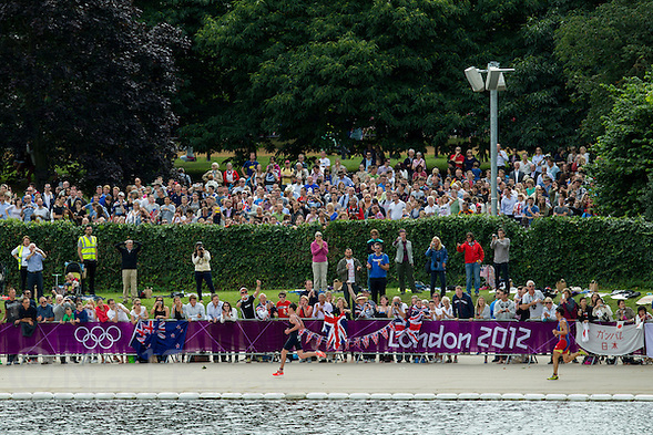 07 AUG 2012 - LONDON, GBR - Alistair Brownlee (GBR) of Great Britain (left) leads Javier Gomez (ESP) of Spain (right) past spectators on the banks of The Serpentine during the men's London 2012 Olympic Games Triathlon in Hyde Park, London, Great Britain .(PHOTO (C) 2012 NIGEL FARROW) (NIGEL FARROW/(C) 2012 NIGEL FARROW)
