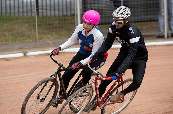 21 JUN 2015 - LONDON, GBR - Charlie-Jane Herbert (left) of Ipswich Eagles challenges Nick Gunkel (right) of East London for position at the first bend during their South East League Two cycle speedway fixture at Canning Town Recreation Ground in London, Great Britain (PHOTO COPYRIGHT © 2015 NIGEL FARROW, ALL RIGHTS RESERVED) (NIGEL FARROW/COPYRIGHT © 2015 NIGEL FARROW : www.nigelfarrow.com)