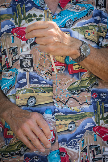 A man in automobile shirt attends the classic car show in Calistoga. (Clark James Mishler)