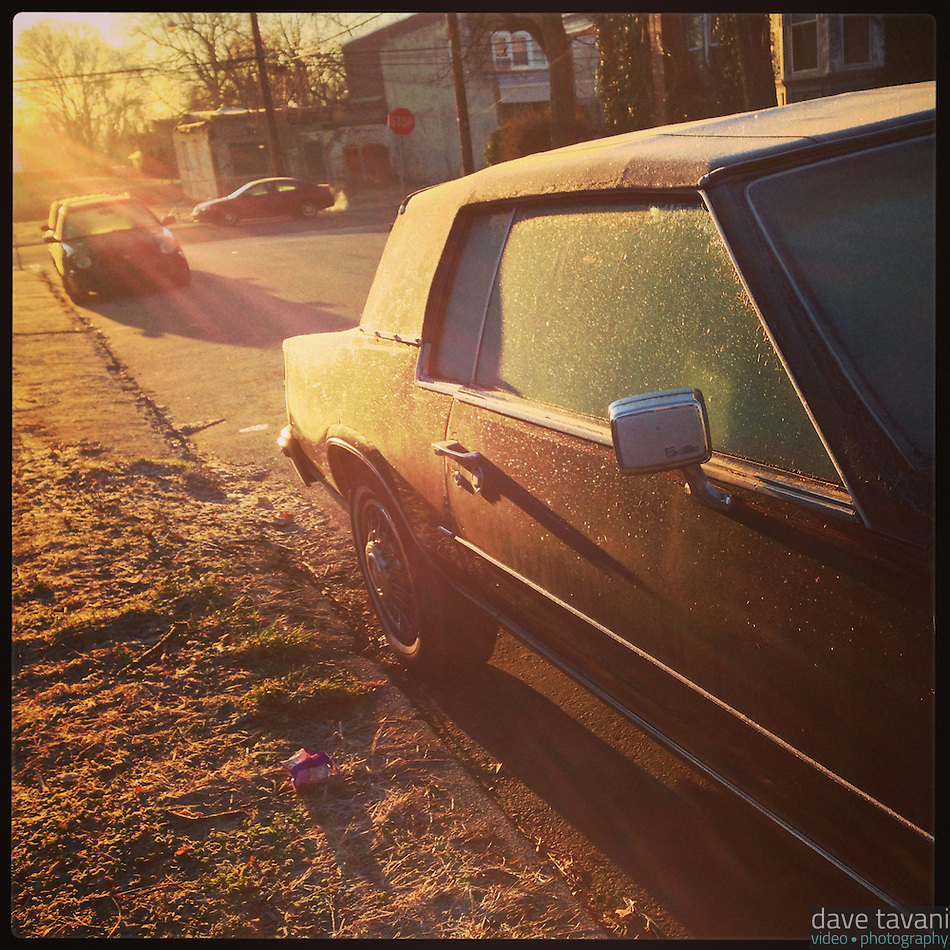 The sun lights up the frosty window of a car on Cherokee Street in the Germantown section of Philadelphia on January 8, 2013. (Dave Tavani)