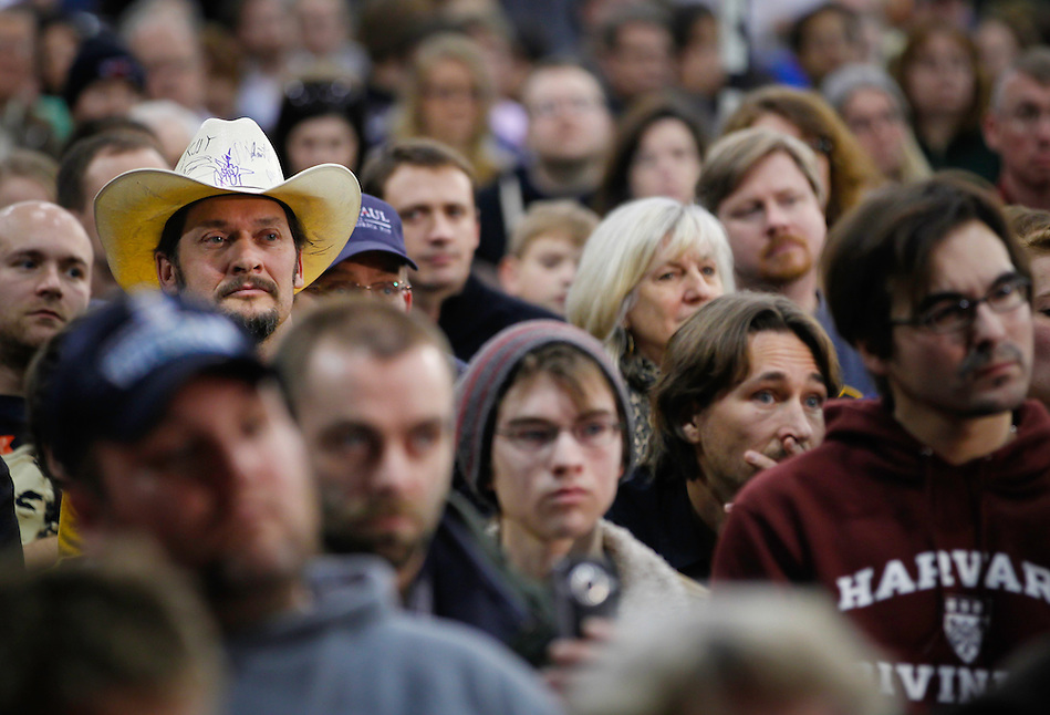 Potential caucus goers listen while Ron Paul speaks during a campaign stop in Des Moines on December 28. (Christopher Gannon)