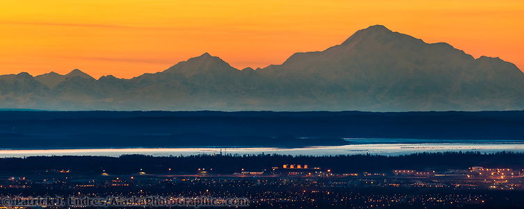Sunset Over The City Of Anchorage Situated Along Cook Inlet With Mt. Denali (right) And Mt. Foraker Of The Alaska Range Mountains In The Background. (Patrick J. Endres / AlaskaPhotoGraphics.com)