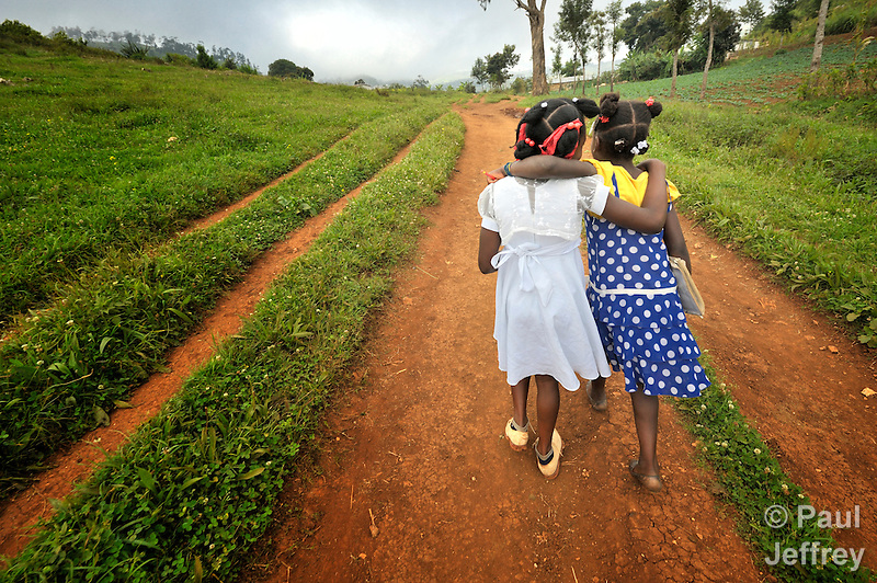 Two girls walk to school in the Haitian village of Foret des Pins. (Paul Jeffrey)