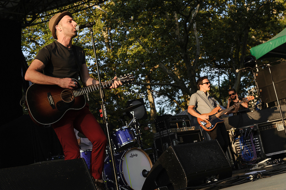 """Photos of the musician Mat Kearney performing live on the """"California 37 World Tour"""" at Central Park SummerStage at Rumsey Playfield, NYC. August 27, 2012. Copyright © 2012 Matthew Eisman. All Rights Reserved. (Photo by Matthew Eisman/WireImage)"""