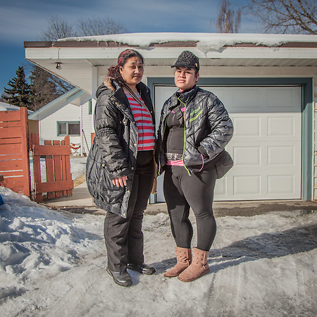 "Sisters Cindy (29) and Elizabeth (20) Lafaele in Anchorage's South Addition neighborhood.  ""We are Samoan and grew up in Hawaii.  After our parents died we came here (Anchoarge) to seek better opportunities.""  lissah05.el@gmail.com (© Clark James Mishler)"