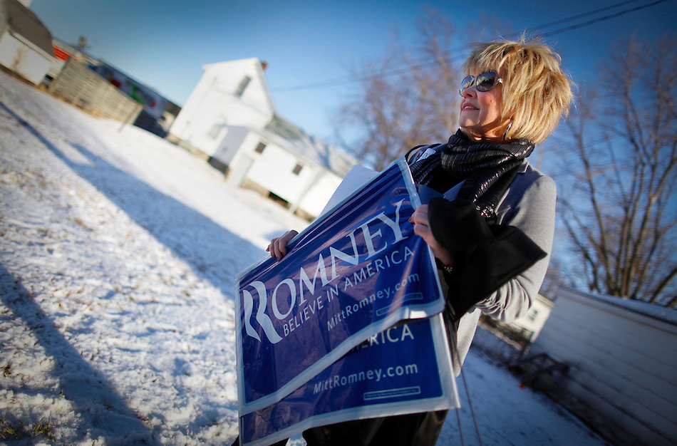 After collecting a few campaign signs, Carey Pomykata of Omaha, Neb. waits to catch a glimpse of Mitt Romney while standing near his tour bus in Atlantic, Iowa on Sunday, January 1, 2012.  (Christopher Gannon/GannonVisuals.com/MCT) (Christopher Gannon)