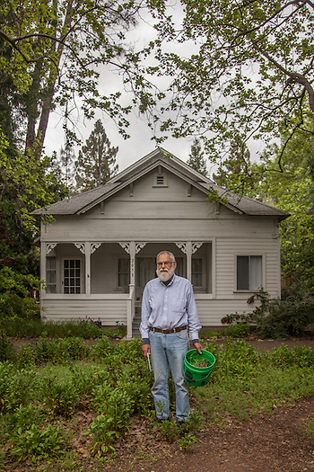 """We moved into this house in 1993...I sewed some seeds here about 10 years ago...not sure what they are but they flower all summer. Now I'm trying to keep the weeds from taking over...be careful where you step."" -Retired software engineer Martin Segal in front of his house on Grant Street in Calistoga (Clark James Mishler)"