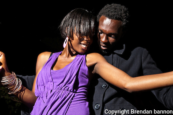Raychelle, 21, PR and advertising student  and Evans Ndega, model, dancing. (Photographer: Brendan Bannon)
