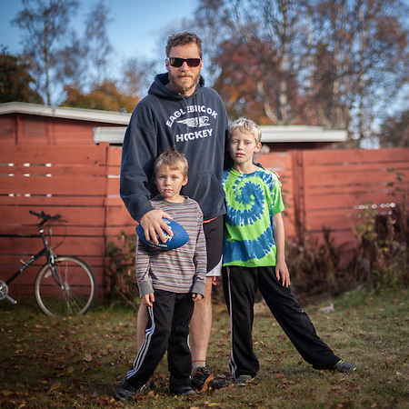 "Wes Cornelison and his sons in their back yard in Anchorage's South Addition.  ""We're working on some foot-work before football practice.""  wescorneli@gmail.com (© Clark James Mishler)"