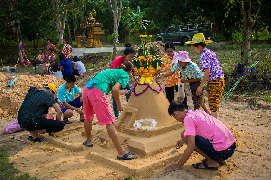 Building sand stupa's on the 1st Day of Songkran 2014 in Rural Nakhon Nayok, Thailand. (Lee Craker)