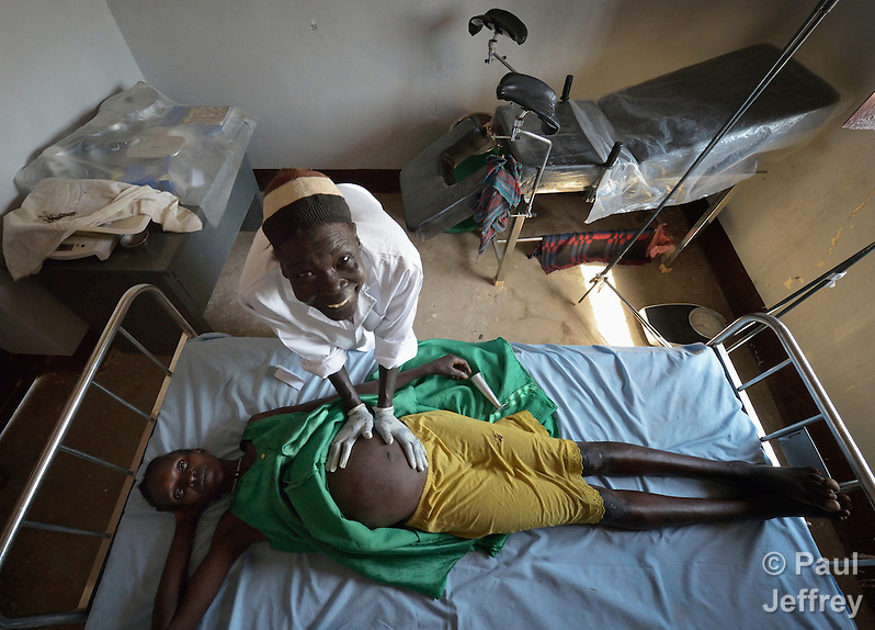 Nyanthak Arop Mahadi, a midwife, examines Nyankiir Makuac Deng in the Caritas clinic in Mading Achueng, a village in Abyei, a contested region along the border between Sudan and South Sudan. Under a 2005 peace agreement, the region was supposed to have a referendum to decide which country it would join, but the two countries have yet to agree on who can vote. In 2011, militias aligned with Khartoum drove out most of the Dinka Ngok residents, pushing them across a river into the town of Agok. Yet more than 40,000 Dinka Ngok have since returned with support from Caritas South Sudan, which has drilled wells, built houses, opened clinics and provided seeds and tools for the returnees. (Paul Jeffrey)