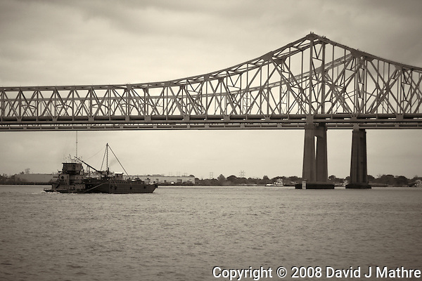 Barge going under Mississippi River Bridge in New Orleans, Louisiana. Image taken with a Nikon D300 and 18-200 mm lens (ISO 200, 50 mm, f/5.6, 1/800 sec). Processed with Capture One Pro (including conversion to B&W). (David J Mathre)
