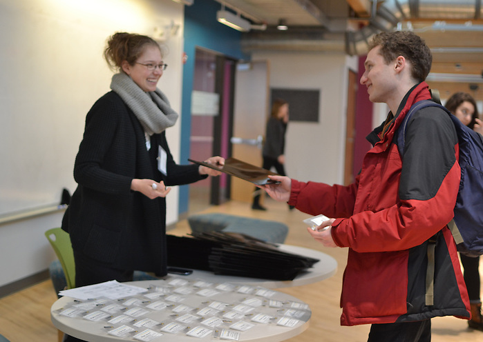 16/2/5 – Medford/Somerville, MA – Christina Fogarasi, program administrator at Tufts Institute for Innovation, receives and distributes name tags and information to participants at Human Health Hack on Feb.. 5, 2016. (Ziqing Xiong / The Tufts Daily) (Ziqing Xiong / The Tufts Daily)