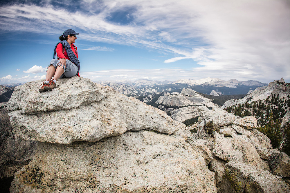 Rock climber on the summit of Tenaya Peak, Tuolumne Meadows, Yosemite National Park, California