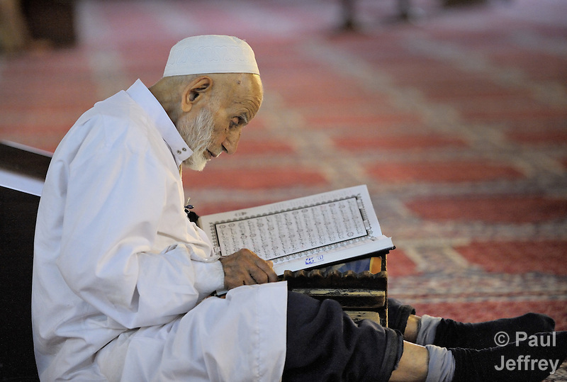 A man reads the Koran inside the Umayyad Mosque in Damascus, Syria. Also known as the Grand Mosque of Damascus, it is one of the largest mosques in the world and one of the oldest sites of continuous prayer since the rise of Islam. A shrine in the mosque is said to contain the head of John the Baptist. (Paul Jeffrey)