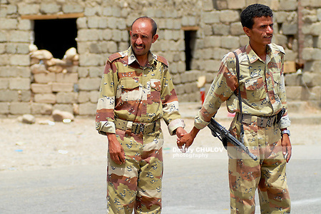 HADRAMAUT VALLEY, YEMEN - SEPTEMBER 10, 2006: Unidentified Yemeni military hold hands at the security checkpoint, Hadramaut valley, Yemen. Tourism in Yemen is dangerous now because of kidnappings. (Dmitry Chulov)