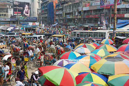 DHAKA, BANGLADESH - FEBRUARY 22, 2014: People go to shopping at the Old market on February 22, 2014 in Dhaka, Bangladesh. Dhaka is one of the most overpopulated cities in the world. (Dmitry Chulov)